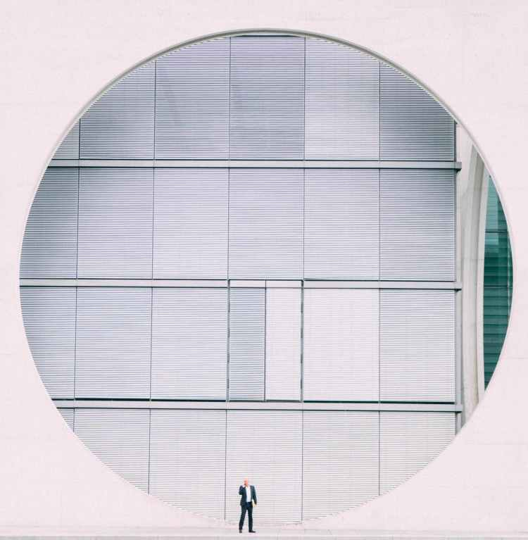 person in front of gray structure