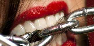 Woman biting a chain