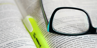 Glasses with highlighter looking at hofh resources
