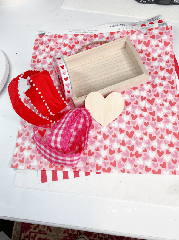 scrapbook paper, ribbon, wooden heart, sign