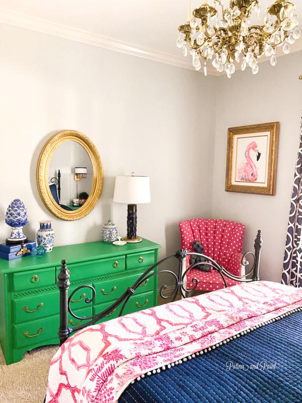 green dresser, pink chair