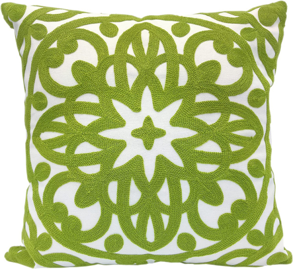 green and white embroidered pillow