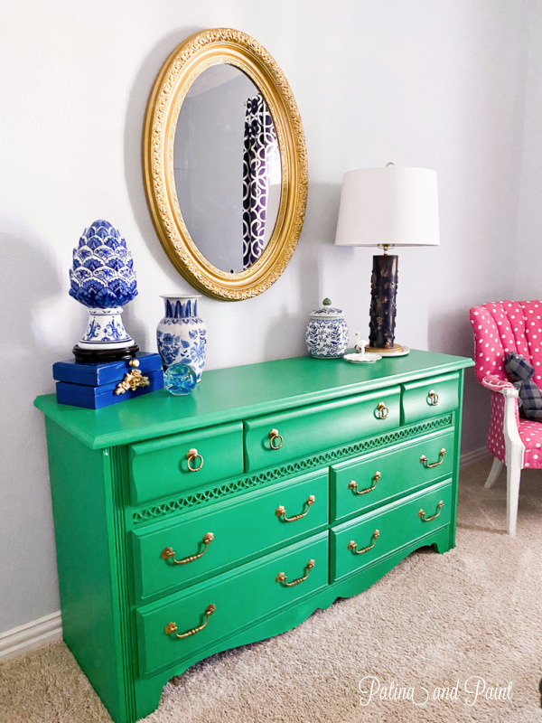 green dresser, mirror, lamp