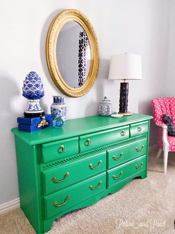 green dresser, mirror, lamp