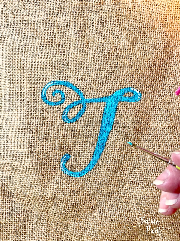 Painted letter T on beach bag