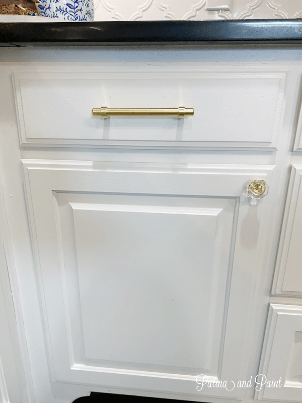 white cabinet, gold hardware