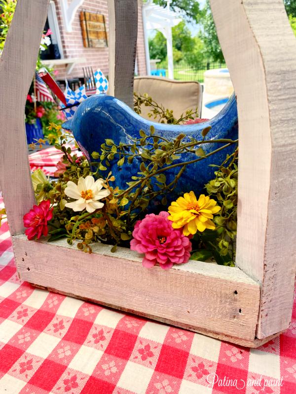 white lantern centerpiece with fresh flowers