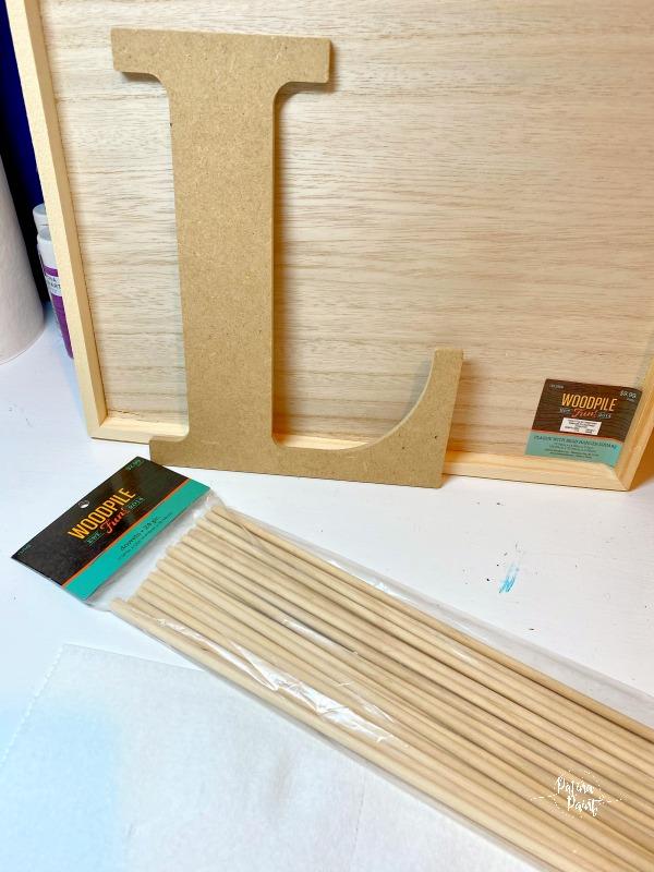 wooden letter, dowel rods