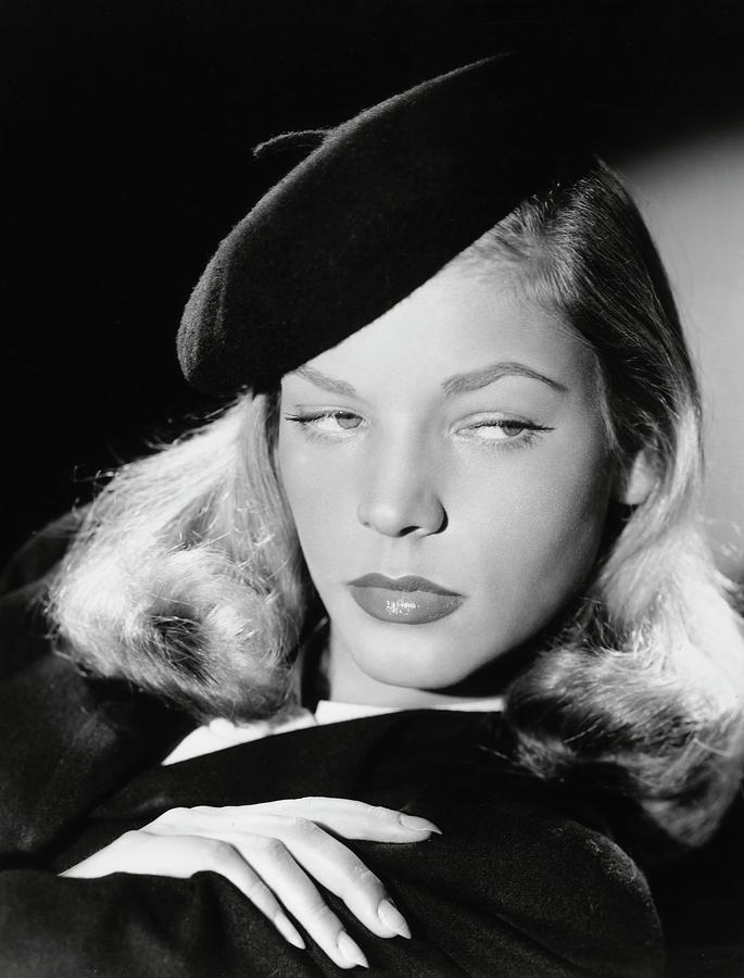 Still photo of Lauren Bacall. Example of chiaroscuro lighting in Film Noir