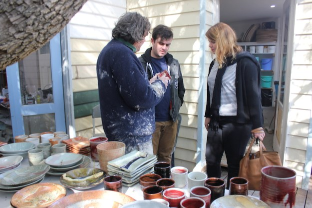 Gordon with customers on open day at Brixton Street Pottery.