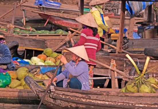 Cantho Vietnam floating market women in boats