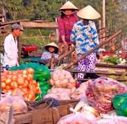 vietnam woman conferring boats