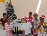 Girls perform a sassy dance at the Christmas party.