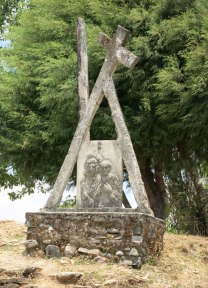 Religious icons like this Station of the Cross outside Letefoho church are commonplace in Catholic Timor.