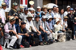 Photographers waiting for the maiko to arrive, Hassaku in  Gion, Kyoto