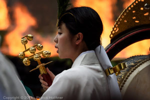 A shrine maiden singing during the Fushimi Inari Hitakisai ceremony
