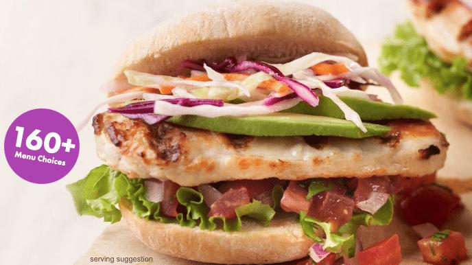 a chicken sandwich with fresh veggies