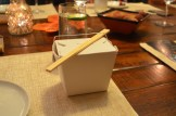"""Course 2, """"boxed up"""" was served in a take-out box."""