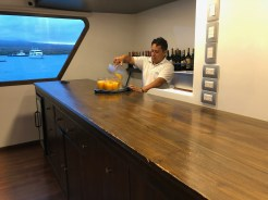Eduardo pouring a welcome juice.
