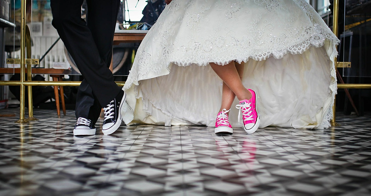 bride and groom in tennis shoes