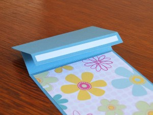 Tape on the fold to support the easel