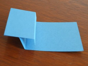 The fold adhered down on card
