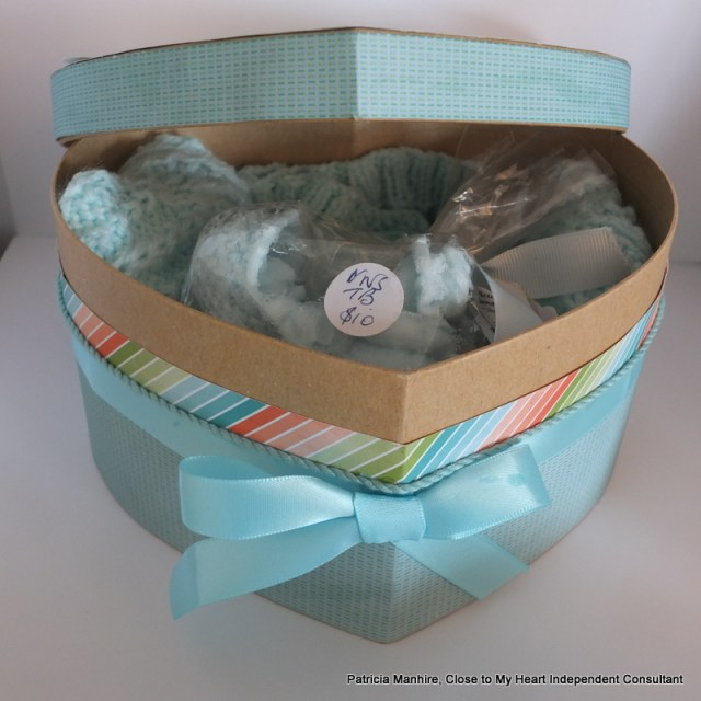Baby gift basket decorated with CTMH Blossom papers.