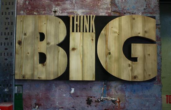 THINK BiG : wood letters mounted on black backround