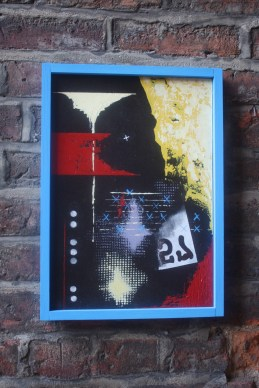 five and seven . . . 57 : painting with blue wood frame