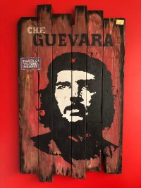 iconic urban style painting of Che Guevara on reclaimed timber