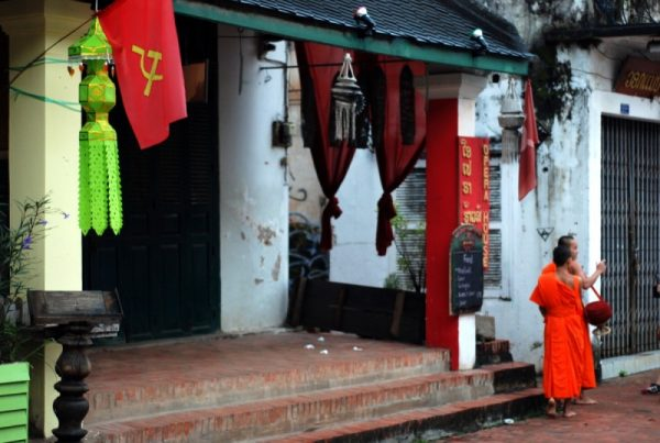 Communist flags and monks in Luang Prabang