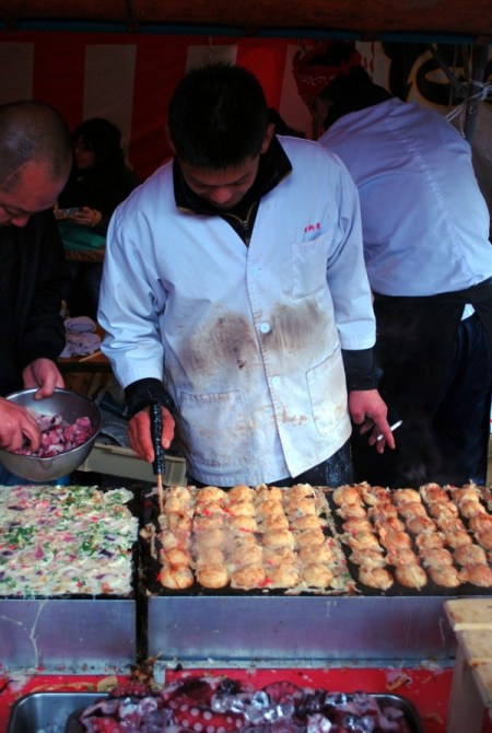 Cooking takoyaki at Kobosan