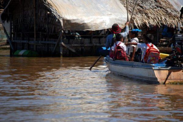Children going to school on the Tonle Sap Lake, Cambodia