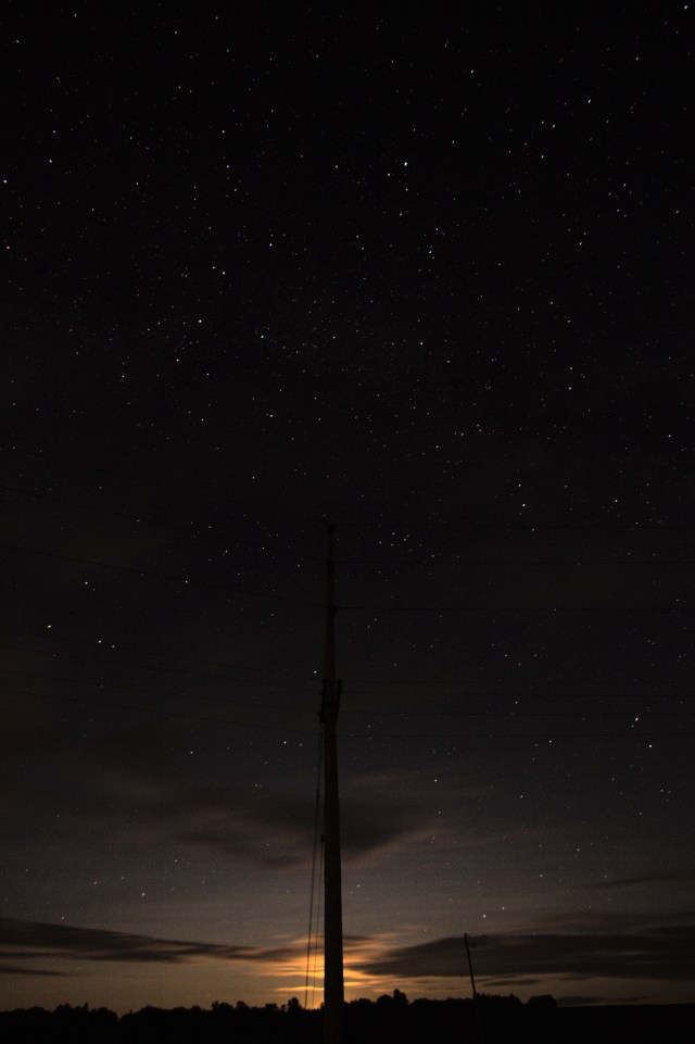 The moon, rising behind a hydro pole