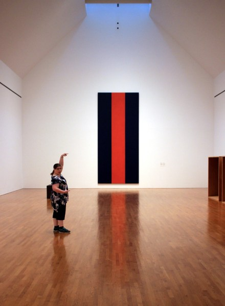 Kathleen poses with Voice of Fire, by Barnett Newman