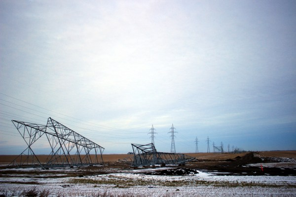 Hydro pylons lie on the ground near Winnipeg