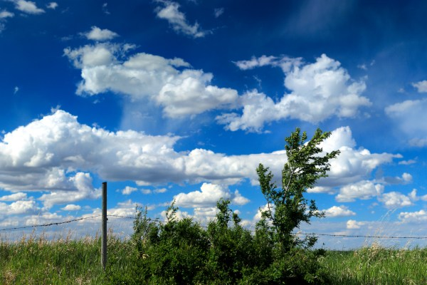 The sky behind a fencepost (Brenizer panorama)