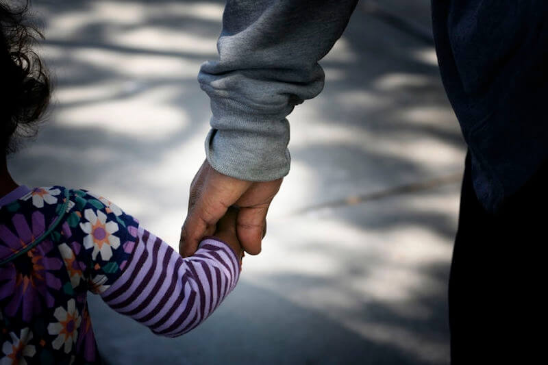 Father's day bible verses with a man holding the hand of a child