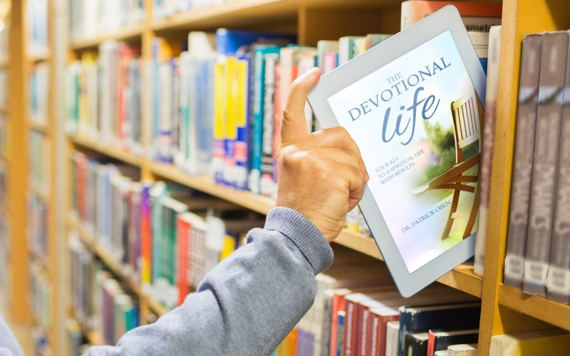 The devotional life book on a book shelf shown on an iPad screen