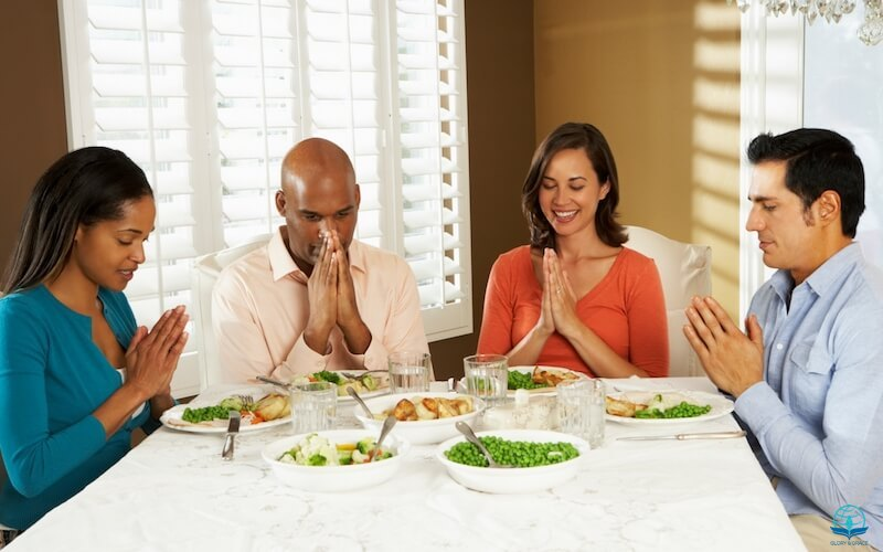 Grace in the Book of Ephesians image showing a group of black and white people on a dinner table