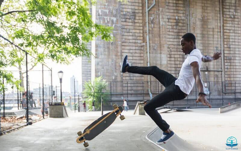 Pride goes before a fall showing a young man falling off his roller board