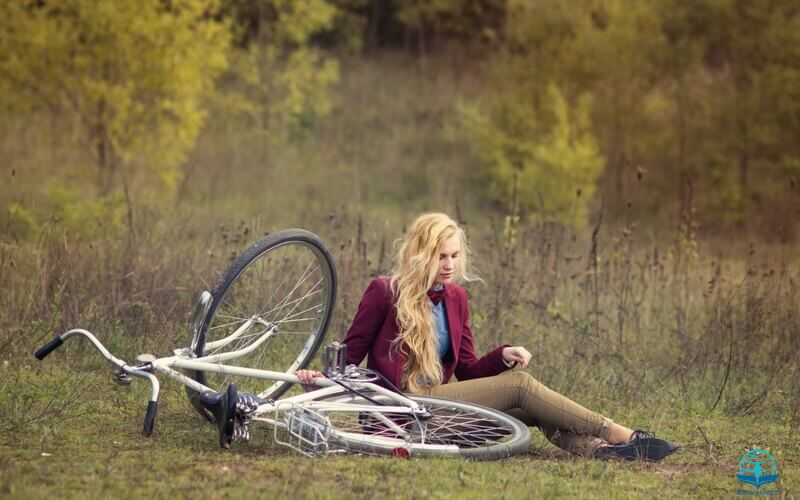 The Lord had given him rest showing a woman resting besides her bicycle