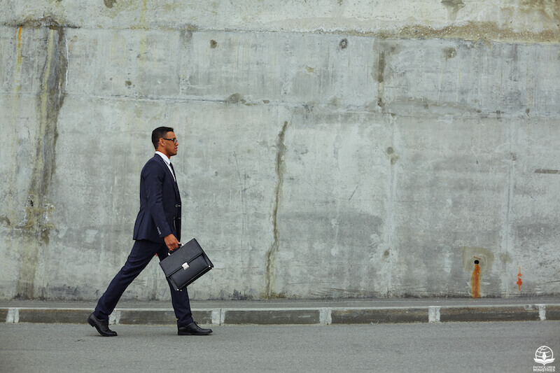 Walking in the Spirit showing a man waking with a briefcase