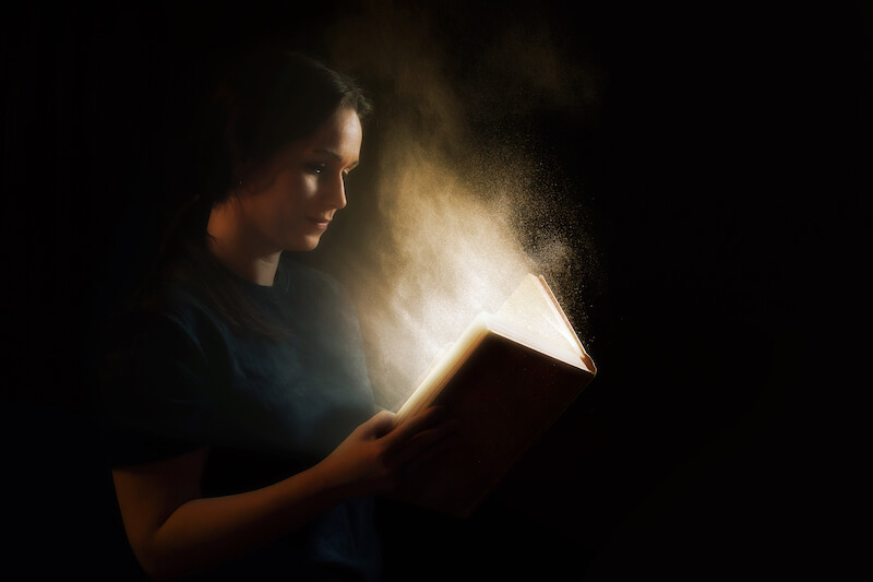Sure Word of prophecy shows a woman reading a book that glows