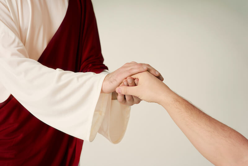 Whom say ye that I am showing an image of Jesus stretching His hand to save someone