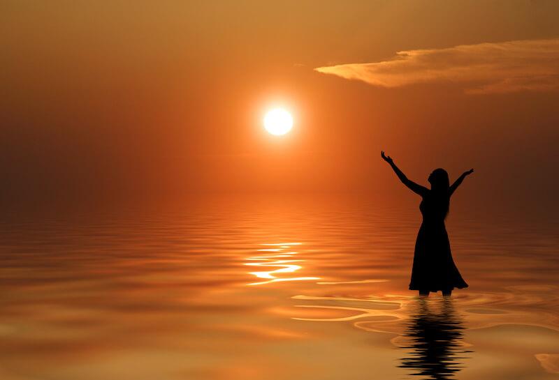 Offer Up Spiritual Sacrifices showing a woman praising God