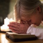 The hour of prayer is a time of fellowship showing a woman praying