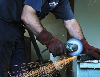 I know your works showing a handyman cutting through iron