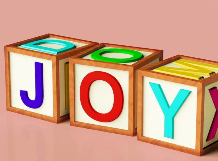 I bring tidings of great joy showing three boxes with the letters of joy