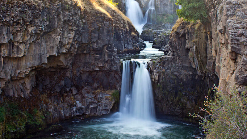 out of your belly shall flow rivers of living water showing a small steam flowing down a rock